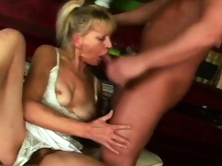 Hot granny is sucking her neighbour's fat cock on dramatize expunge couch.