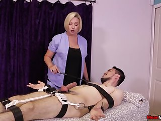 Strict blonde masseuse gives a Femdom handjob nearly a bound client