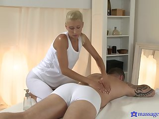 Blonde woman gets intimate during massage with along to hot hunk