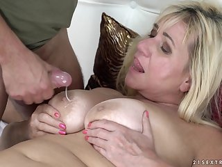 Mature busty blonde Pam Pink gets cum all over her huge tits