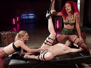 Mistress Daisy Ducati humiliates her two slaves added to fists them